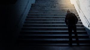 Lonely man on stairs