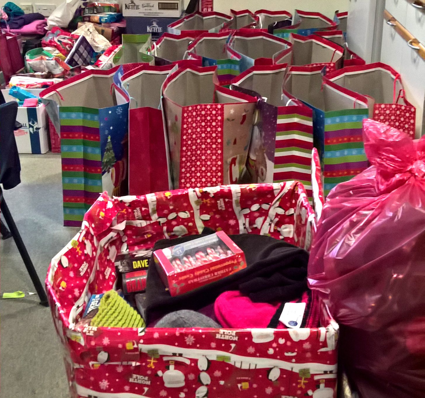 Donating Christmas Gifts: Gift Bags Distributed To Local Homeless People